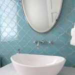 Vanity With White Marble, White Sink, Round Mirror, Blue Arabesque Tiles