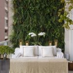 Verandah With White Floor, White Sofa, Brown Cofee Table, Plants On The Wall Back