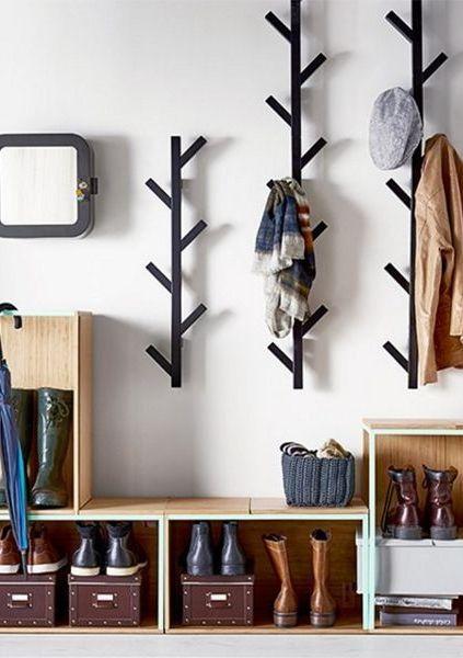 vertical coat racks from black metal, storage for shoes under