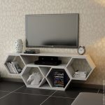 White TV Cabinet With Hexagonal Shelves Arranged As One Cabinet