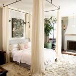 White Bed With Canopy On Rolling Rail Black Metal, Wall Lamp For Sleeping