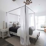 White Bed With Metal Support, Thin Metal Lines For Canopy And White See Through Material