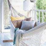 White Bohemian Hammock With Pillows, On Balcony With White Wooden Floor, Screen, White Wooden Fences