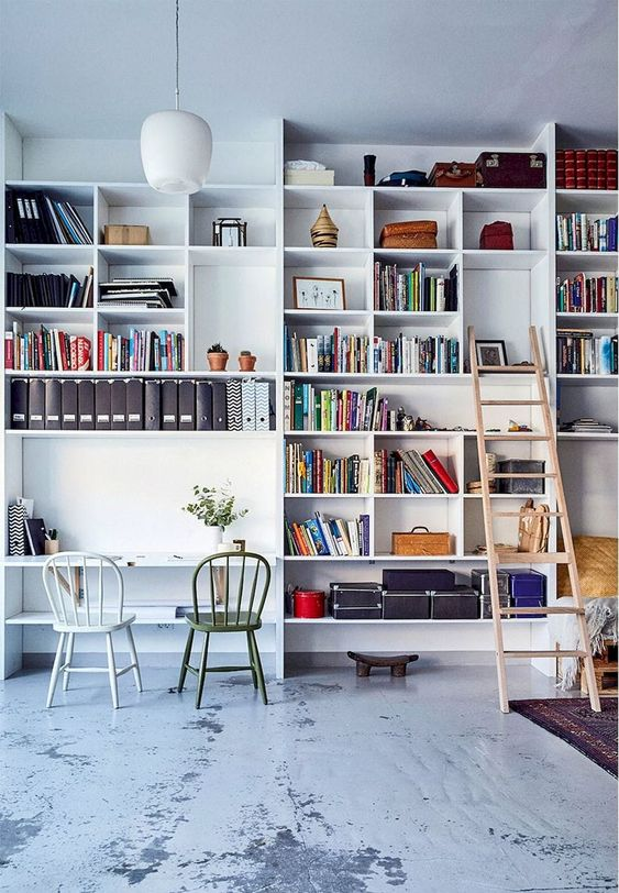 white large bookshelves with large empty shelves for study
