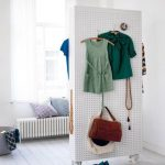 White Pegboard Room Divider On Two Sides With Wheels