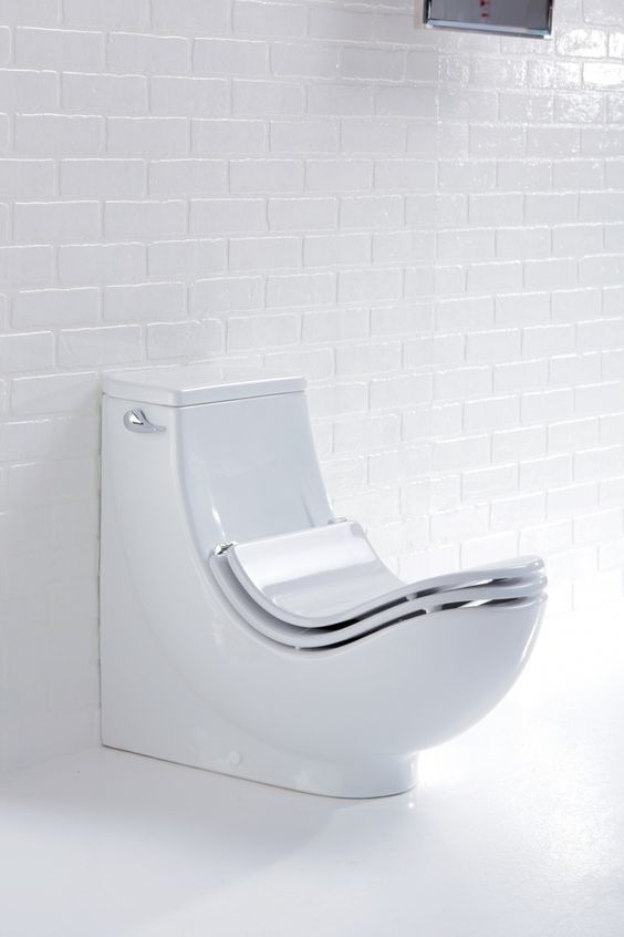 white toilet with sloping part of theback of the seat