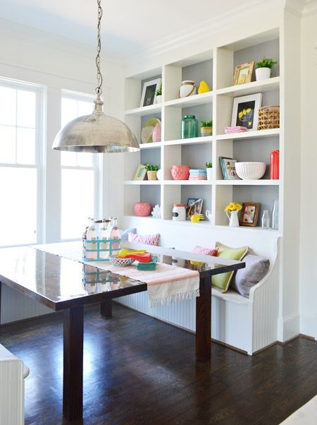 white wooden bench on dining nook with shelves built in with the bench, wooden table