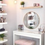 White Wooden Table, Golden Chair With Pink Cushion, Wooden Shelves On Top Of Golden Framed Mirror, White Shelves On The Back