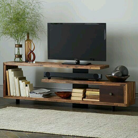 wooden assymetrical modern tv cabinet with a drawer, decorations, shelves
