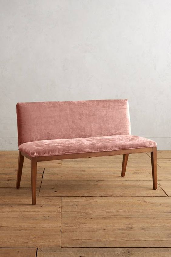 wooden bench with pink upholstery