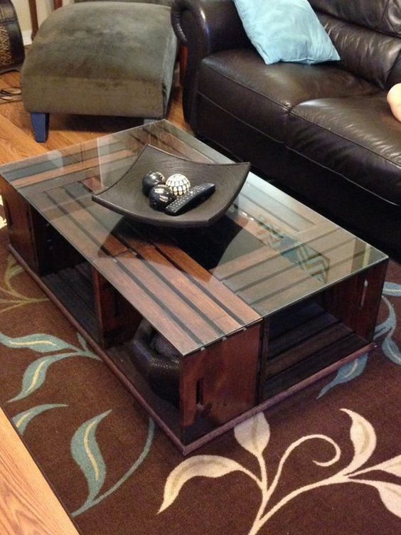 wooden coffee table from crates with clear glass top