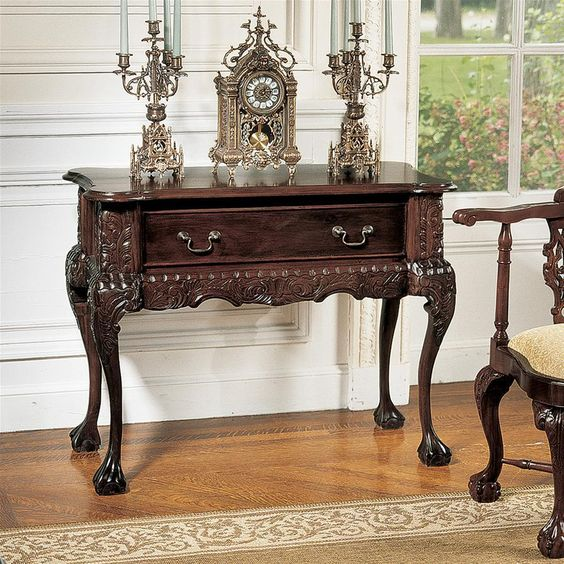 wooden console table in dark brown with a drawer with knobs