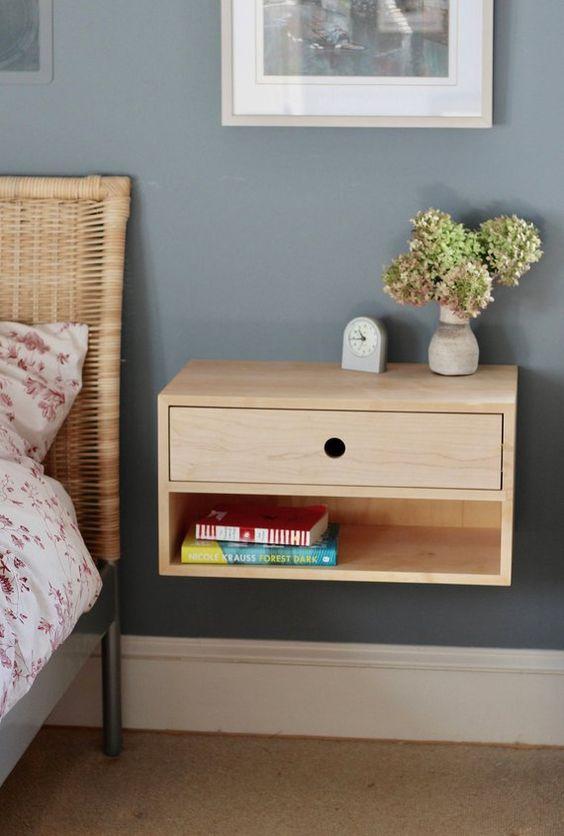 wooden floating bedside table with one drawer, shelf, vase, clock