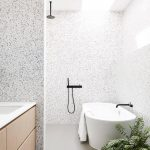 Wooden Floating Vanity With White Sink, White Terrazzo Wall, Mirror, White Tub