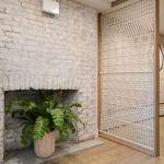 Wooden Framed Room Divider With White Macrame Motives