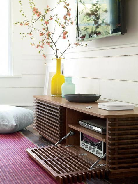 wooden media storage console under the TV