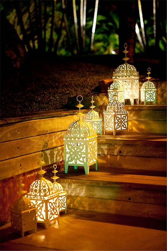 Moroccan lamps on the wooden stairs in patio
