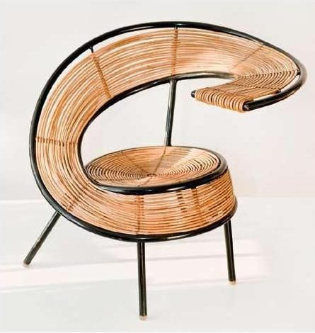 a unique circling rattan chair with black metal support