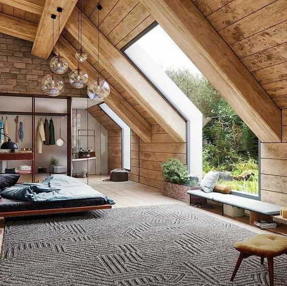 attic bedroom, wooden floor, wooden wall, wooden sloping ceiling, angled glass windows, rug, wooden bed platform, glass pendants, walking closet
