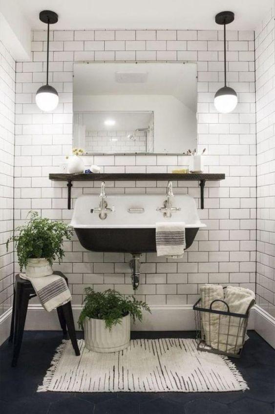 bathroom, black hexagon floor tiles, white subway tiles, ball pendant, black vintage sink, black stool, black floating shelves