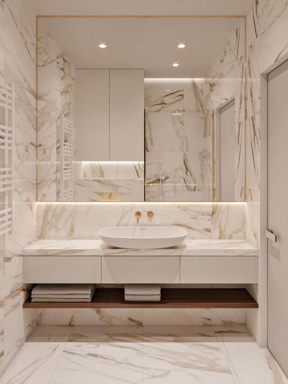 bathroom, marble tiles floor, wall, backsplash, white drawers with marble top, white sink, mirrors, wooden shelf