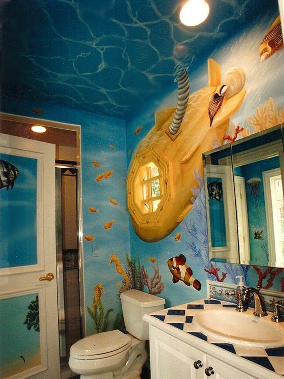 bathroom, mural of underwater, white toilet, white cabinet wth diamond top, white sink, windows as submarine, mirror