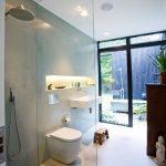 Bathroom, White Floor, Grey Wall, Wooden Floor In Shower Area, White Toilet, White Floating Sink, Built In Shelves, Tub And Shower Outside