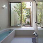Bathroom, White Floor Tiles, White Wall Tiles, White Tub, Shower, Sliding Windows, Small Patio