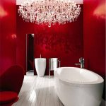 Bathroom, White Wooden Floor, White Round Tub, Red Wall, Red Chair, White Sink, Crystal Chandelier