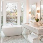 Bathroom, White Zigzag Pattern Floor Tiles, White Wall, White Ceiling, White Marble Sink, Acrylic Shelves, White Tub, Round Cove With Glass Wall