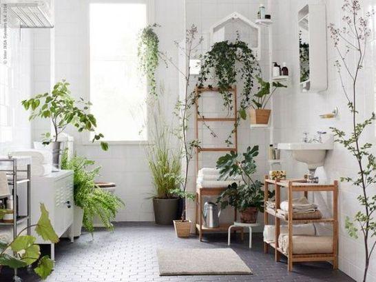 bathroom with geometric floor tiles, white wall tiles, white toilet, white cabinet, wooden rack, wooden shelves, white sink, mirror