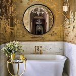 Bathroom With Marble Floor, Half Bottom Wall In Marble, Golden Paintings On Half Top Wall, Golden Side Table With Glass Top