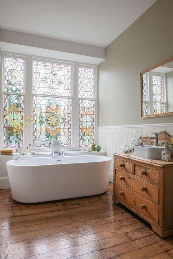 bathroom, wooden floor, wooden cabinet, white cladding, grey wall, white tub, mosaic large windows