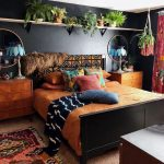 Bedroom, Beuge Rug, Colorful Rug, Warm Brown Bedding, Dark Grey Wall, Floating Shelves For Ponts, Wooden Cabinet On Bedside, Round Mirrors, Blue Table Lamps