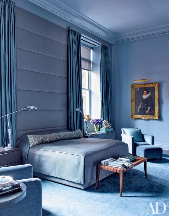 bedroom, blue wall, blue accent wall, blue bedding, blue rug flooring, blue lounge chair, blue chair, lamp floors, bench