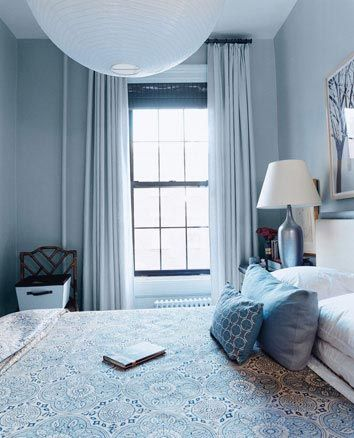 bedroom, blue wall, blue bedding, white pendant, blue pillows, blue table lamp with white cover, blue curtain