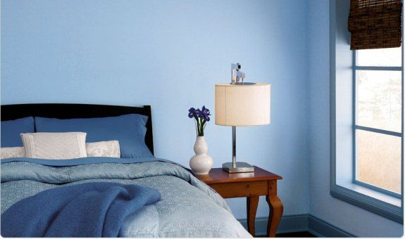 bedroom, blue wall, blue bedding, wooden side table