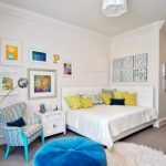Bedroom, Grey Flooring Rug, Blue Chair, Blue Ottoman, White Cabinet, White Bed With Corner Wraparound Headboard, White Wall, White Ceiling, White Chandelier