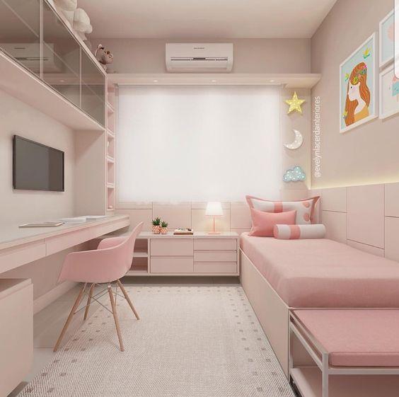 bedroom, light pink floor, pink bed platform, pink bed, pink cabinet, pink built in shelves, table, entertainment center, pink modern midcentury chair