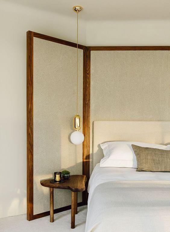 bedroom, white floor, white bedding, white headboard, wooden wraparound added headboard, wooden bedside table, white bulb hanging bedside lamp