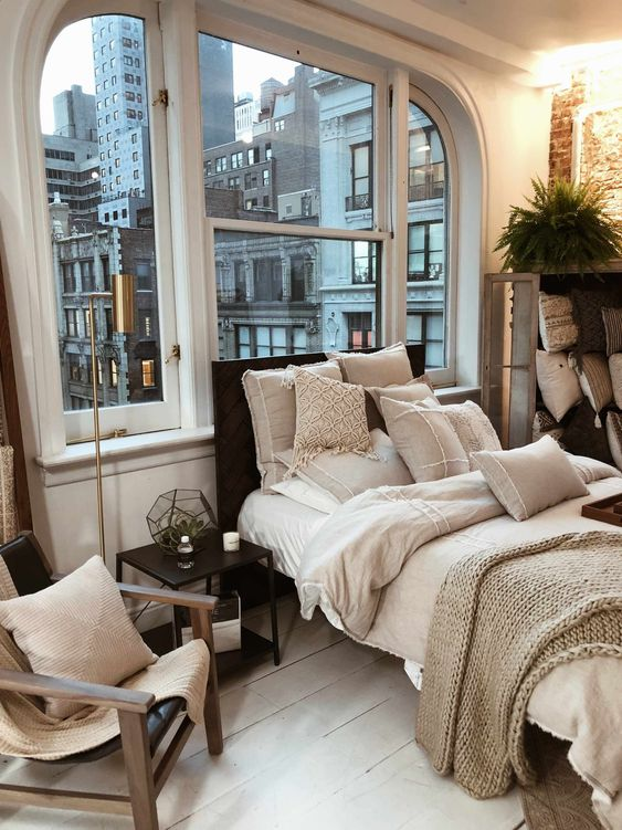 bedroom, white wooden floor, half round top with extended legs windows, square windows, white wall, bed, side table, chair