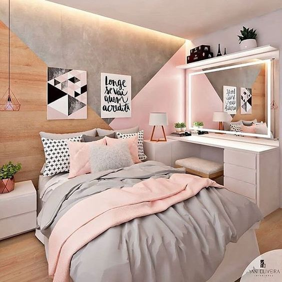 bedroom, wooden floor, grey pink bedding, white makeup table with LED framed mirror, wooden pink grey accent wall, white side table