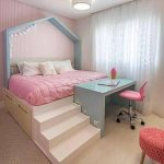 Bedroom, Wooden Floor, Rug, High Bed Platform With Pink Bedding, Storage Under, Blue Study Table, Pink Chair, Pink Crochette Seating Stool, Pink Wall, White Curtain