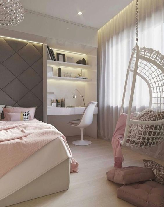 bedroom, wooden floor, white bed platform, pink bedding, white swing chair, white built in study with white chair