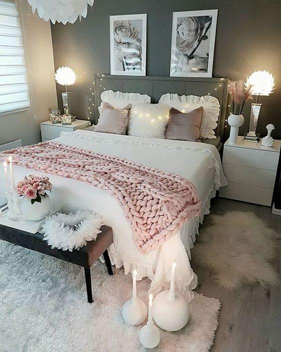 bedroom, wooden floor, white rug, white bedding, grey wall, white side table