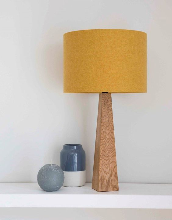 bedside table lamp with wooden body, mustard cover, white table
