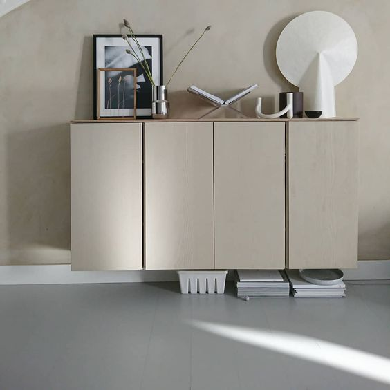 beige floating IVAR cabinet, beige wall, grey flooring