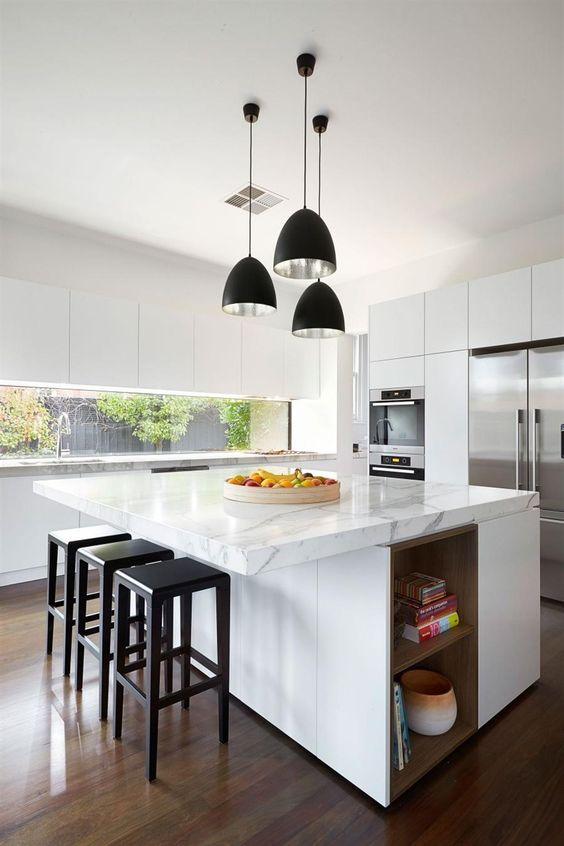 black cone pendant, white ceiling, white marble top on white island, wooden floor, black stool, white cabinet