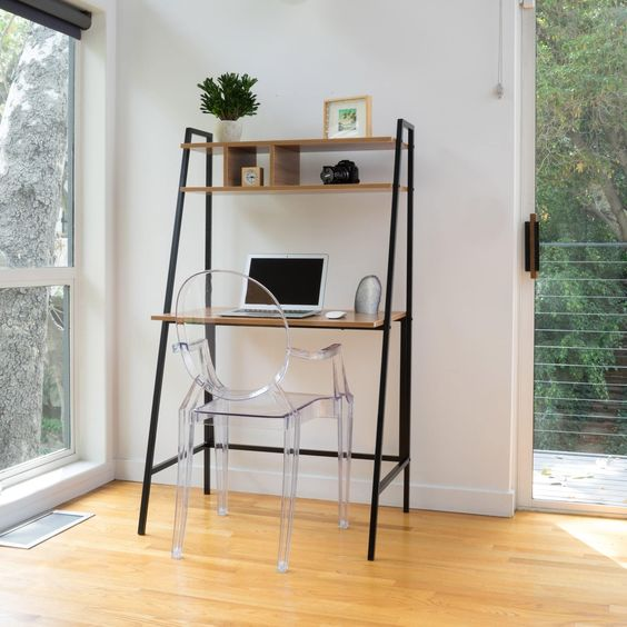 black metal ladder with wooden chelves, table, acrylic chair, wooden floor, white wall