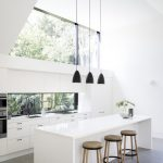 Black Small Cone Pendants With Strained Wire, White Island, White Wall, White Cabinet, Stools, Grey Floor
